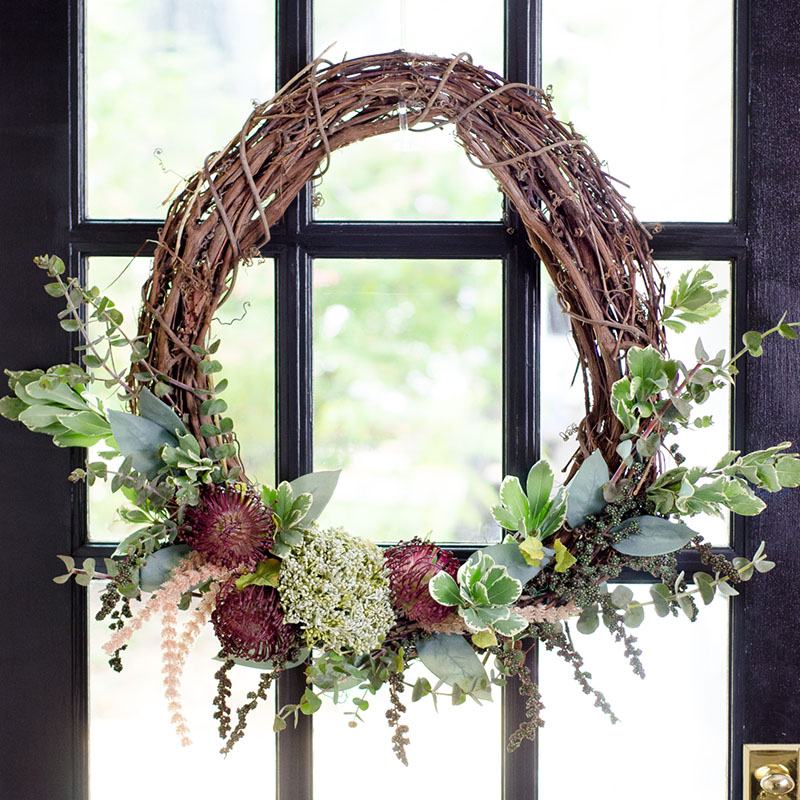 A Farmhouse DIY Grapevine Wreath that has the look of the outdoors!