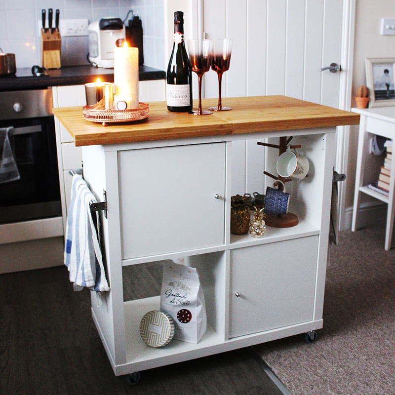 This Kitchen Island Hack was made with a Kallax and then put on wheels.  Looks great... stores tons and a great working space!
