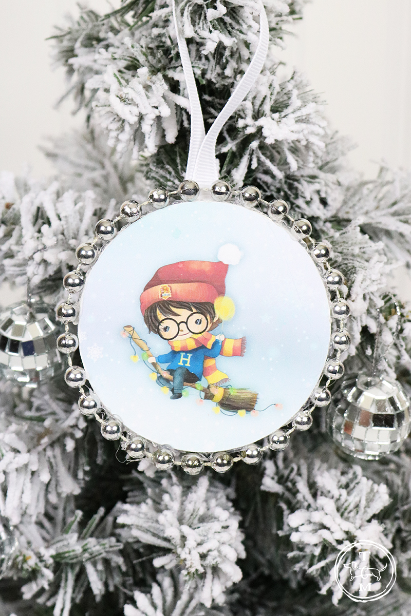 These DIY Dollar Store Christmas Ornaments with Free Printables are Magical. Come and join Harry Potter and Friends, Spiderman and Friend, The Star Wars Gang and the Pretty Princesses!