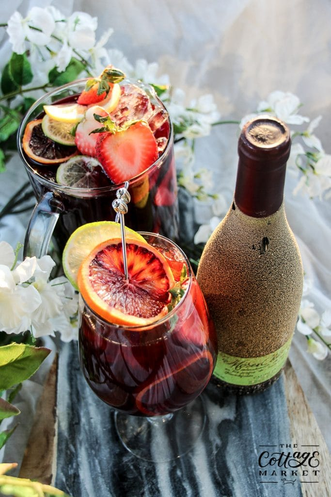 https://thecottagemarket.com/wp-content/uploads/2020/06/Citrus-Summer-Sangria-12-683x1024-1.jpg